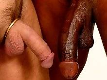 Black dude tenders his big cock and offers his white friend to join him.