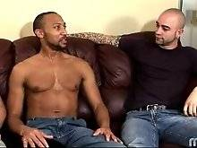 two horny white guy are trying to seduce cute black fallow. They ask him questions about his sexual behavior.